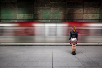 Girl in front of passing underground train