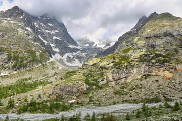 View of mountain peaks with glaciers in Val Ferret, Aosta valley, Italy