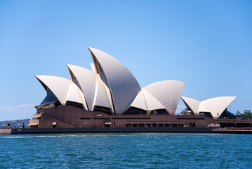 View at Sidney opera house in Sydney, Australia. It was Designed by Danish architect Jorn Utzon and was opened at October 20, 1973.