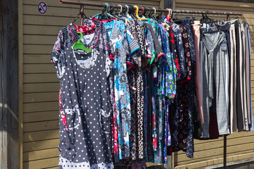 various clothing hung in sale on flea market