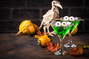 Halloweens spooky drink green martini cocktail Wall mural
