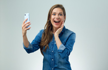Happy woman doing selfie with smart phone.