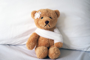Teddy bear and bandage. Injury concept