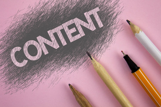 Text sign showing Content. Conceptual photo Website containing exclusive and containing rich information written Pink background Pen and pencils next to it.