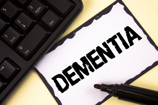 Conceptual hand writing showing Dementia. Business photo text Long term memory loss sign and symptoms made me retire sooner written Sticky Note paper plain background Marker Keyboard.