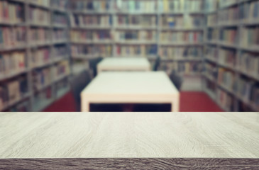 education and learning concept of empty wooden table in library. for product display, presentation...