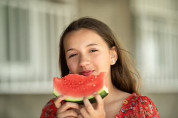Portrait of a young brunette little girl with watermelon, summer outdoor