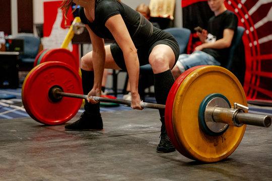 women powerlifter start attempt deadlift competition in powerlifting