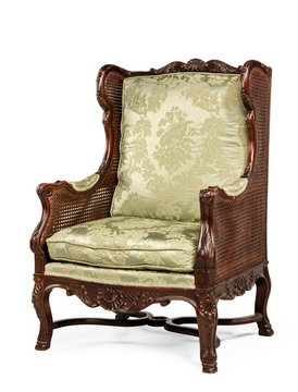 old antique wing arm chair upholstered  green  isolated on white