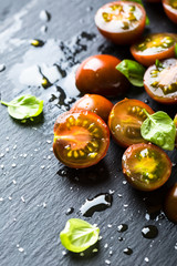 Appetizer of fresh cherry tomatoes, basil and olive oil