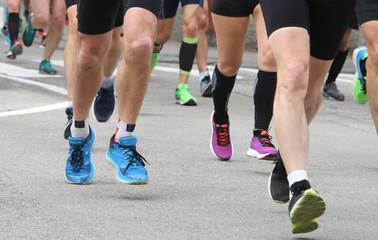 athletes participate in a road marathon