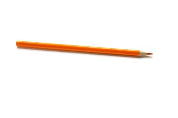 Orange color pencil on white background. - Image