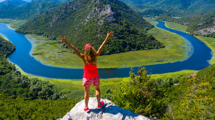 panormic view of landscape of lake skadar in Montenegro, woman happy or holiday concept