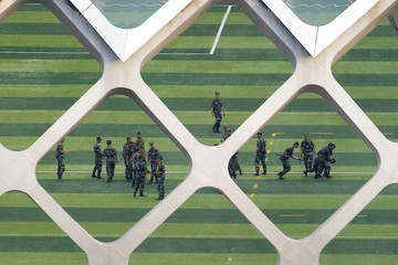Chinese soldiers practice detaining a person on the grounds of the Shenzhen Bay Sports Center in Shenzhen across the bay from Hong Kong