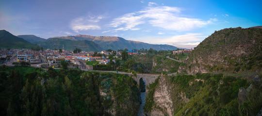 Aerial sunrise view to Colca river and Sabancaya mountain, Chivay, Peru