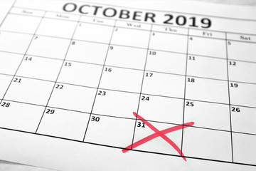 Brexit deadline concept with October sheet of monthly calendar and the date on which England will leave the European Union, October 31st, marked