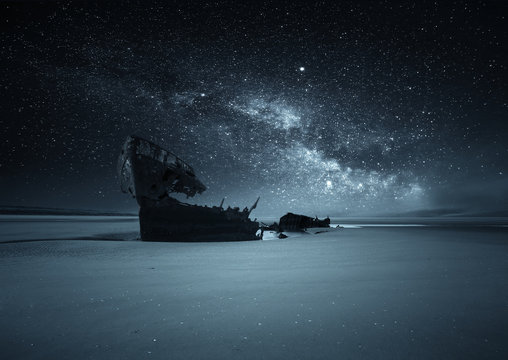 Shipwreck on a beach against the milky way, Dublin, Ireland