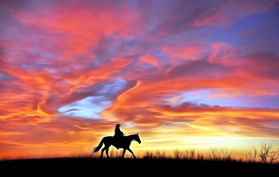 Lonely cowboy against the evening sky