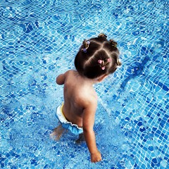 Overhead view of a girl standing in a swimming pool