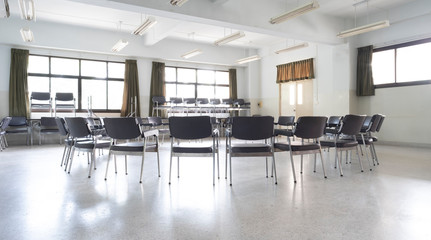 A university or college lecture room for business law with arm chairs organized in a circle so that all participants can see each other.