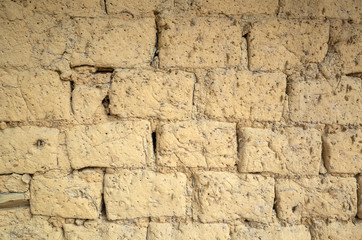 old yellow mud brick wall background