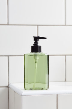 Close up of glass spray bottle with cosmetic