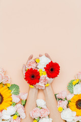 Anonymous hands holds flowers