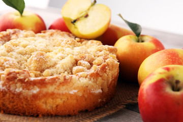 Wall Mural - Apple pie or homemade cake with apples on wood. Delicous dessert apple tart