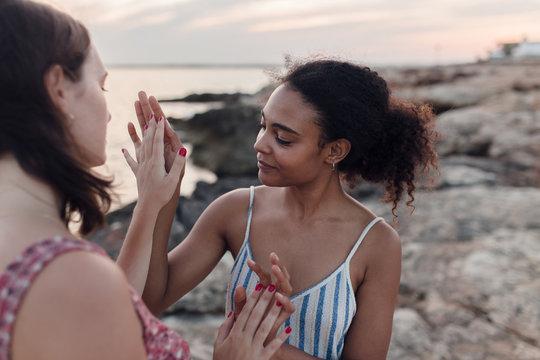 Two women touching