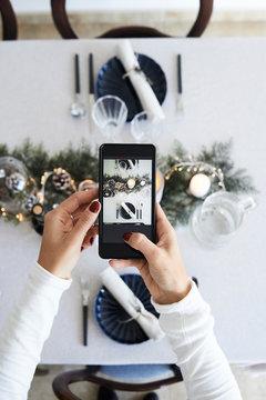 Taking photo Christmas dinner table.