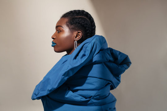 Fashionable black woman in blue coat