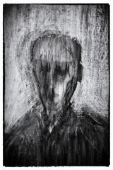 Sombre half-erased portrait
