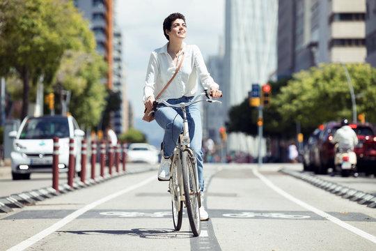 Woman with bike on bicycle lane
