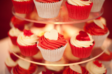 Red cupcakes on a glass stand stock photo