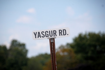 A street sign for Yasgur Rd., on what was Max Yasgur's farm, the original site of the Woodstock Festival, on its 50th anniversary in Bethel, New York