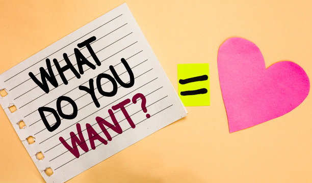 Text sign showing What Do You Want question. Conceptual photo Tell me your desires requests demands ambition Transverse white paper with words equal love heart on Peach color base