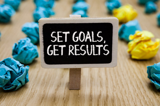 Text sign showing Set Goals, Get Results. Conceptual photo Establish objectives work for accomplish them Paperclip hold written chalkboard behind paper lumps on woody deck