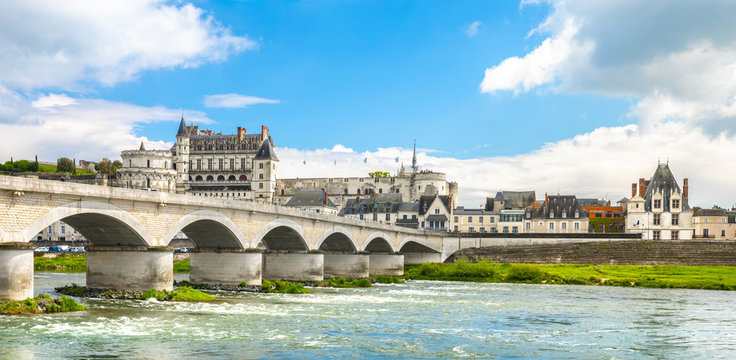 Beautiful view on the skyline of the historic city of Amboise with renaissance chateau across the river Loire. Loire valley, France