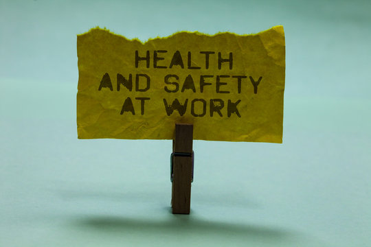 Text sign showing Health And Safety At Work. Conceptual photo Secure procedures prevent accidents avoid danger Paperclip hold torn yellow page written brown words sky blue background