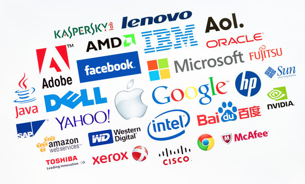 KIEV, UKRAINE - MAY 22, 2014: A logotype collection of well-known world top companies of computer technologies on a monitor screen. Include Google, Apple, Microsoft, IBM, Adobe, Intel and other logos.