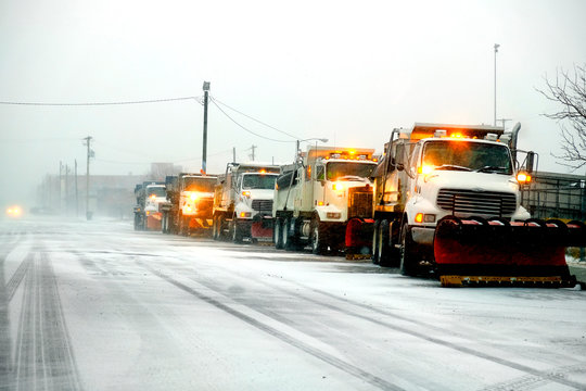 Snow Plows in Severe Blizzard Preparing for Storm