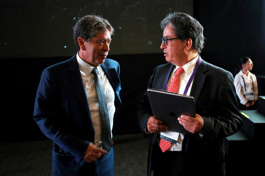 President of the National Business Association of Colombia (ANDI) Bruce Mac Master speaks with Colombia's Finance Minister Alberto Carrasquilla Barrera, during the Fourth Colombian Business Congress in Medellin