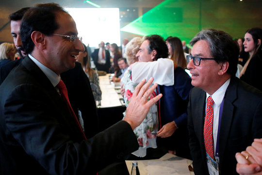 Colombia's Minister of Commerce Jose Manuel Restrepo speaks with Colombia's Finance Minister Alberto Carrasquilla Barrera during the Fourth Colombian Business Congress, in Medellin