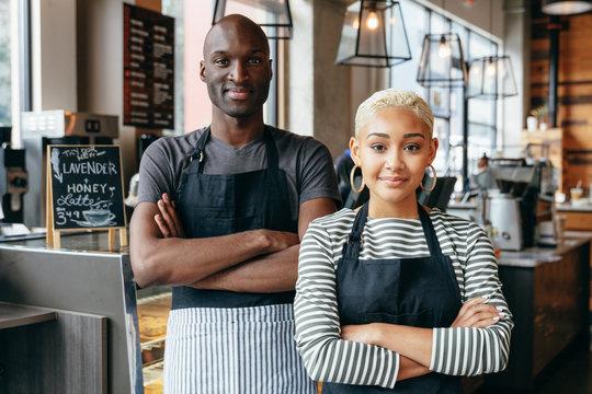 Two diverse cafe baristas