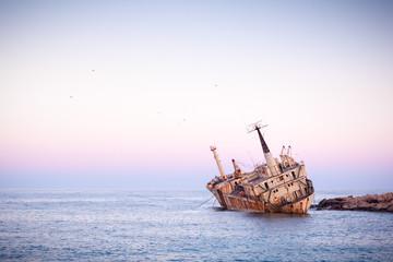 Abandoned rusty ship Edro III near Pegeia, Paphos, Cyprus at sunrise