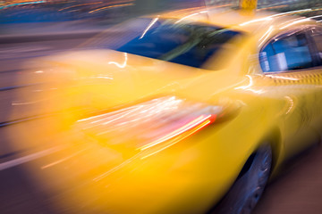 Blurred yellow taxi car on the road