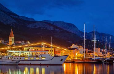 View of the resort town of Makarska on a summer night, in Makarska Riviera, Croatia