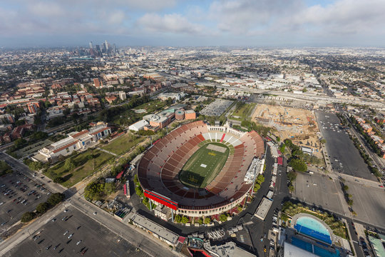 Aerial view of the historic Coliseum stadium with downtown in background on April 12, 2017 in Los Angeles, California, USA.
