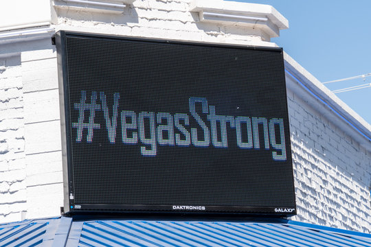 OCT 13 2017 LAS VEGAS NV: #Vegas Strong banner message, flowers and gifts at the memorial park by the Mandalay Bay on the Vegas Strip to remember victims killed in the Las Vegas attack shooting