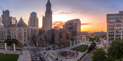 Boston business downtown at sunset with old custom house tower